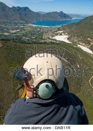 Man flying over Hout Bay, Cape Town, South Africa - Stock Photo