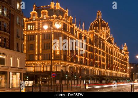 Knitsbridge ,Harrods Department store at night,South Kensington,London,England - Stock Photo