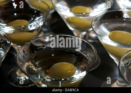 Martini and green olive - Stock Photo
