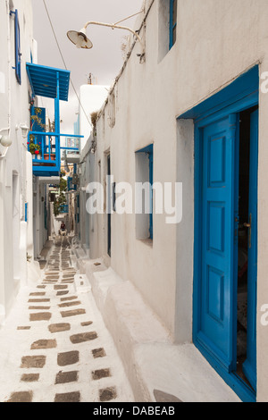 A typical narrow street and whitewashed houses, Chora, Mykonos Town, Mykonos, Greece - Stock Photo
