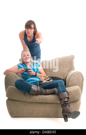 Teenage boy helping his mother to play a video game. - Stock Photo