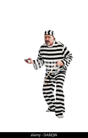 Shifty looking escaped convict with a gun. - Stock Photo