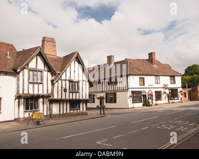 Half-timbered wooden shops and houses in the medieval village Lavenham, Suffolk, UK - Stock Photo