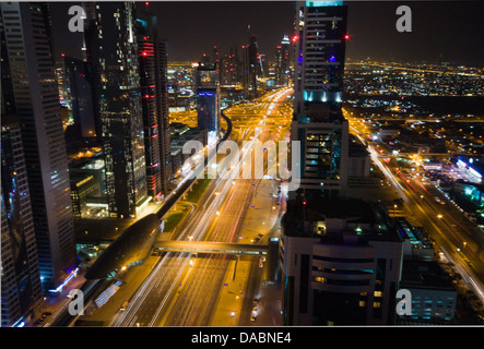 Financial District in Dubai at night - Stock Photo