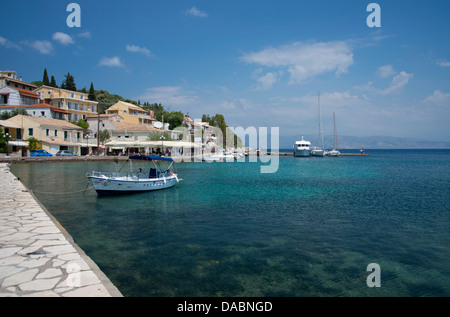 Boats in the harbour in Kassiopi on the northeast coast of Corfu, The Ionian Islands, Greek Islands, Greece, Europe - Stock Photo