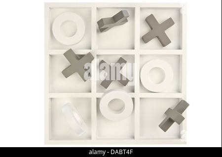 Wooden noughts and crosses game board in gray and white colors and mixed stones isolated in white background - Stock Photo