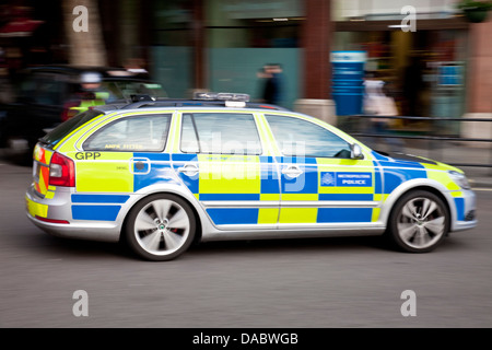 Police Car, Charing Cross Road, London, England - Stock Photo