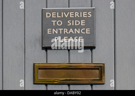 Door Sign Stating Please Use Side Entrance Stock Photo