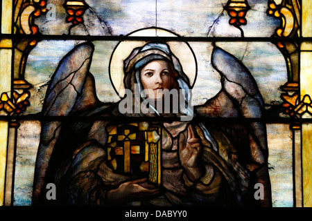 Stained glass window by Louis Comfort Tiffany showing an angel holding the Bible, The American church in Paris, - Stock Photo