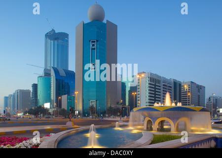 City skyline on Rashid Bin Saeed Al Maktoum Street at dusk, Abu Dhabi, United Arab Emirates, Middle East - Stock Photo