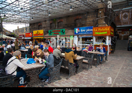 Eating area in front of the food stalls Stables Market in Camden Town district London England Britain UK Europe - Stock Photo