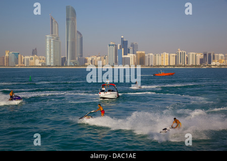 View of city from Marina and Jet ski Water sport, Abu Dhabi, United Arab Emirates, Middle East - Stock Photo