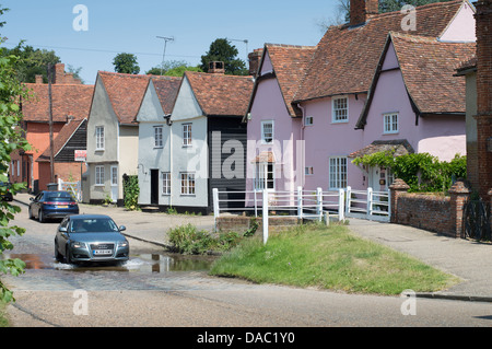 A car driving through The Splash, the ford running through the center of Kersey, a picturesque village in Suffolk, - Stock Photo