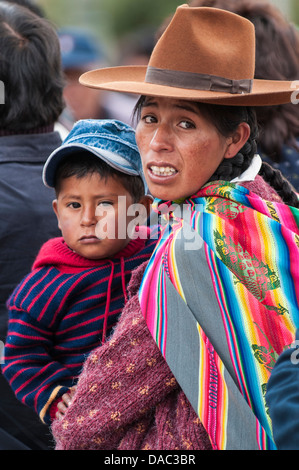Inca Incan Mother Woman In Traditional Blanket And Carrying Child Stock Photo