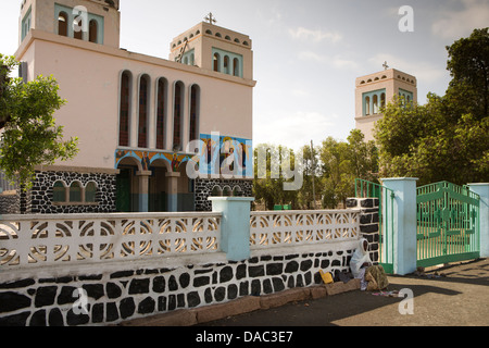 Africa, Eritrea, Massawa, Tualud, beggar in shade outside St Mary's catholic Cathedral Church - Stock Photo