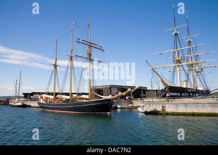 Ebeltoft Denmark EU Restored Fregatten Jylland in dock of museum and Zar sailing ship moored preserved screw-propelled - Stock Photo