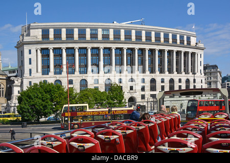 London open top sightseeing tour buses at Unilever House Blackfriars City of London England UK - Stock Photo