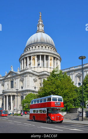 St Pauls Cathedral with red Routemaster bus on number 15 heritage tourist route - Stock Photo