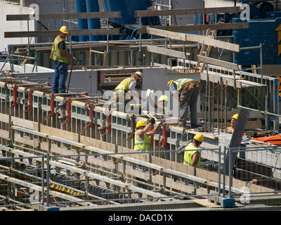 Large building project, the new train station of Breda, the Netherlands, with group of people working. - Stock Photo