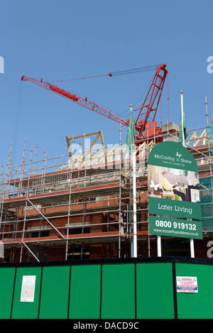 A McCarthy and Stone construction site building accommodation for later living ( portrait view ) - Stock Photo