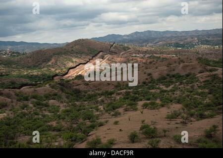 July 10, 2013 - Nogales, Arizona, United States - The ''next generation'' version of the border fence between the - Stock Photo