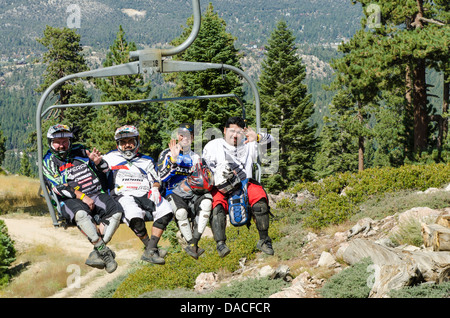 Mountain bikers on chairlift at Big Bear Lake, California. - Stock Photo