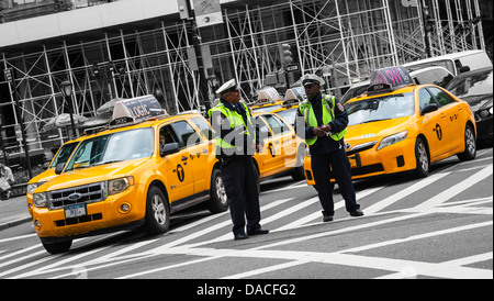 Two policemen on traffic duty on a New York Street, Manhattan, NYC, USA. - Stock Photo