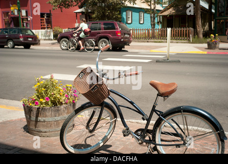 Bicycle parked on a town sidewalk. - Stock Photo
