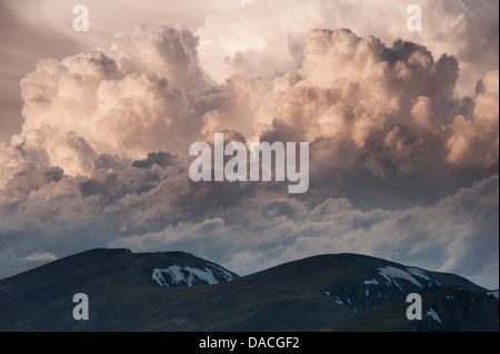 Storm clouds grow menacingly above the tops of the 11,000 feet mountains of the Rocky Mountains. Colorado, USA. - Stock Photo