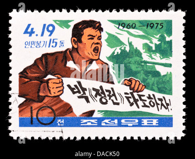 Postage stamp from North Korea depicting the April 19 South Korea People's Uprising (fifteenth anniversary). - Stock Photo