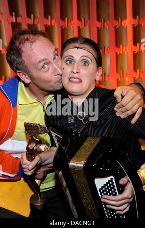 Musician Carmela De Feo receives the music prize an poses with comedian Emmanuel Peterfalvi also known as Alfons, at the Bavarian Cabaret Prize awards in Munich, Germany, 27 September 2011. Since 1999, the prize is anually awarded to artists from German-speaking countries in four different categories. The ceremony will be broadcasted on Bavarian Television TV channel on 7 October a