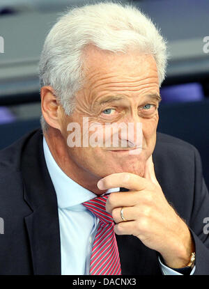 German Federal Transport Minister Peter Ramsauer (CSU) follows the debate during question time at the German Bundestag - Stock Photo