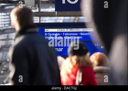 A destination board informs passengers on interruptions of railway traffic at the central train station in Berlin, - Stock Photo