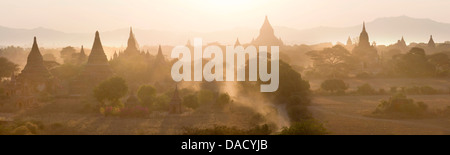 Panoramic view at sunset over the plain and temples of Bagan from Shwesandaw Paya, Bagan Central Plain, Myanmar - Stock Photo