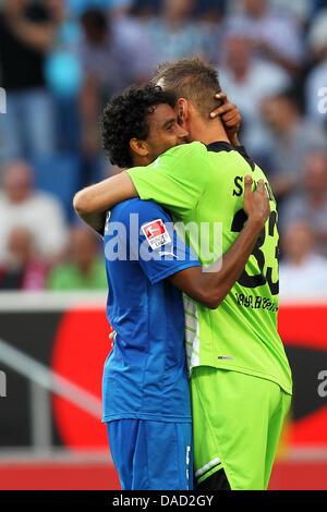 Hoffenheim's Marvin Compper (L) and goalkeeper Tom Starke hug each other after the German Bundesliga soccer match - Stock Photo