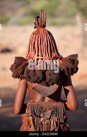 Himba woman showing traditional leather clothing and jewellery, Kunene Region (formerly Kaokoland) in the far north - Stock Photo