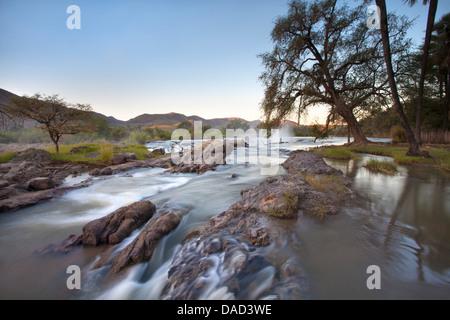 Kunene River which forms the border between Namibia and Angola, near Epupa Falls, Kunene Region (formerly Kaokoland), - Stock Photo