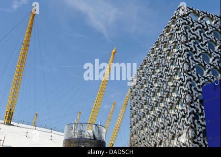 Mosaic facade building by O2 arena, Greenwich, London, England, United Kingdom. - Stock Photo