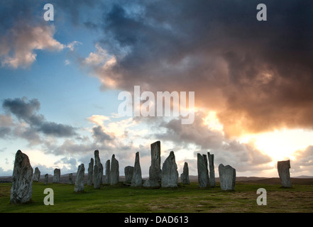 Standing Stones of Callanish at sunset with dramatic sky in the background, near Carloway, Isle of Lewis, Scotland, - Stock Photo