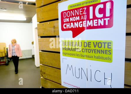 An election poster lettered with the word 'Munich' is seen inside a polling station in Munich, Germany, 09 October - Stock Photo