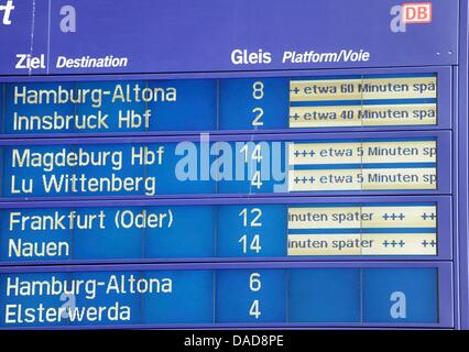 A destination board informs passengers on delays at the central train station in Berlin, Germany, 12 October 2011. - Stock Photo