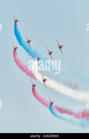 British Royal Air Force Red Arrows Military Aerobatic display team fly their Hawk Jets in Concorde formation at - Stock Photo