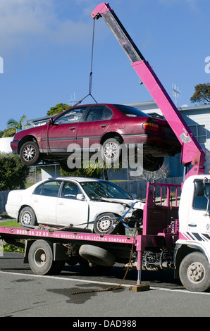 Man towing damaged car over a tow truck on July 01 2013.Many tow companies have the capability to store vehicles - Stock Photo