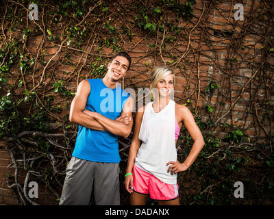 Young man and woman ready for exercise - Stock Photo