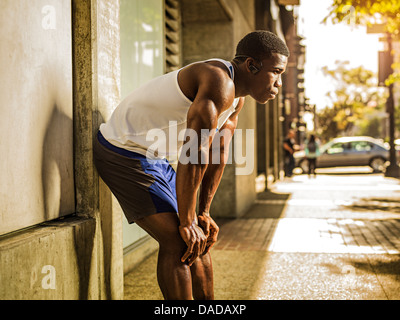 Runner stopping to catch breath - Stock Photo