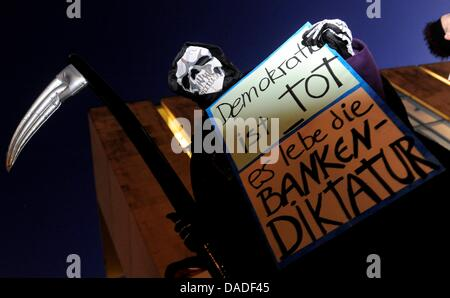 An Attac activist protests in front of the Chancellory in Berlin,Germany, 21 October 2011. Protesters demands include - Stock Photo