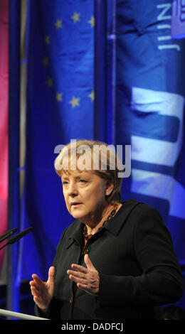 German Chancellor Angela Merkel speaks next to a European flag on Germany Day of the Junge Union (Youth Union) at - Stock Photo