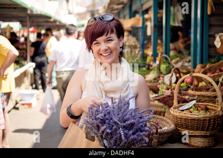 Happy young women at the farmers market - Stock Photo
