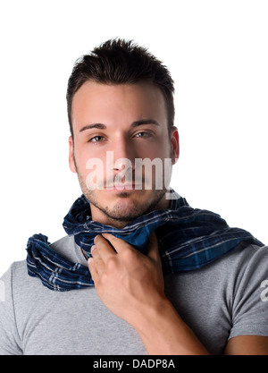 Suffering young man with scarf, holding his neck because of throat ache - Stock Photo