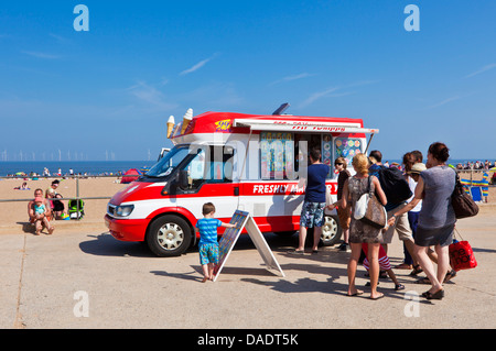 People queueing for an ice cream from an ice cream van parked on Skegness beach promenade Lincolnshire England UK - Stock Photo
